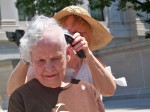 Long-time OVEC board member Elinore Taylor shears her hair. Photo by Janet Keating