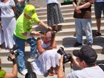 Larry Gibson shaves Paula Swearigen's locks during May 31 End MTR protest. Photo by Janet Keating.