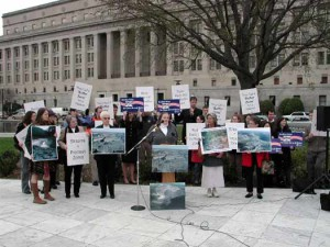 On March 30, 2004, in front of the U.S. Department of the Interior, Joan Mulhern of Earthjustice (at the podium) opens a press conference she arranged. Among the speakers where OVEC organizer Maria Gunnoe, Coal River Mountain Watch's Mary Miller, West Virginia Highland Conservancy's Cindy Rank and Robert Kennedy, Jr.
