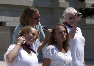 Donna Branham, second from left, bottom row, at an event in 2012, where several women shaved their heads in protest of mountaintop removal coal mining. Photo by Vivian Stockman.