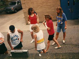 Crystal (red shirt, white shorts) and the crew engaged in musical activism