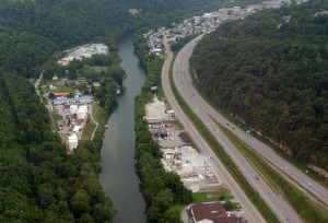 """Freedom Industries tank """"farm"""" on the Elk River. Photo by Vivian Stockman taken in 2014.  The tank farm is now razed, but you can still get wafts of the sickening MCHM smell."""