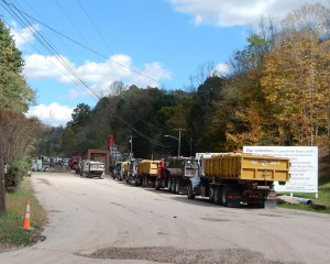 Trucks with drill cuttings line up at a WV landfill. Photo by Bill Hughes