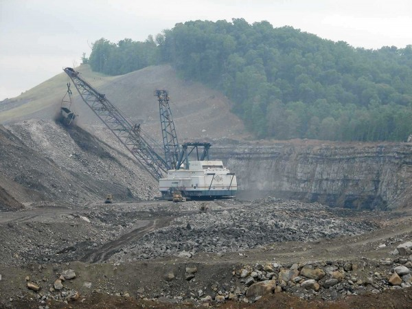 "The layers of ""icing"" and the ""cake"" can be seen in this shot of a dragline in operation at another mountaintop removal site (the Hobet complex on Mud River). To the coal industry, our amazing forests are also ""overburden."" Photo by Vivian Stockman."