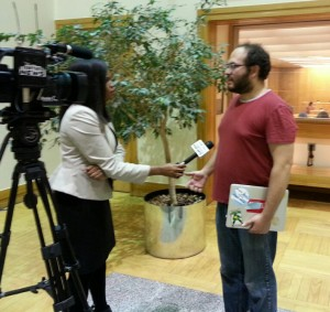Joe Solomon speaks with a TV news reporter at the PSC hearing. Photo courtesy Advocates for a Safe Water System.