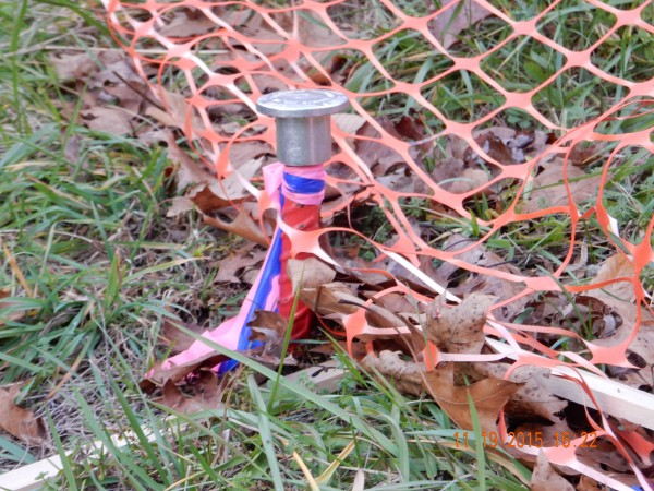 This stake indicates permanent property lines and corners of property; it's a one-inch steel rod with an aluminum cap.