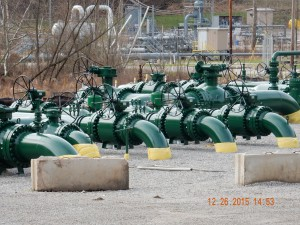 A congested collection of EQT pipe assemblies in downtown Mobley, WV, the birth-place of pipelines. EQT is in the midst of acquiring land in the area. While we do not like to see residents displaced for any amount of money, at this point no one should be living in this valley anymore, especially young kids. Photo by Bill Hughes.