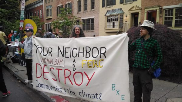 Wildfire joins BXE outside the home of FERC Chairman Norman Bay.