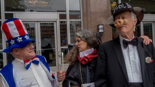 Uncle Sam cowers at ISDS Trade Tribunal Grim Reaper, who loves up on Big Oil.