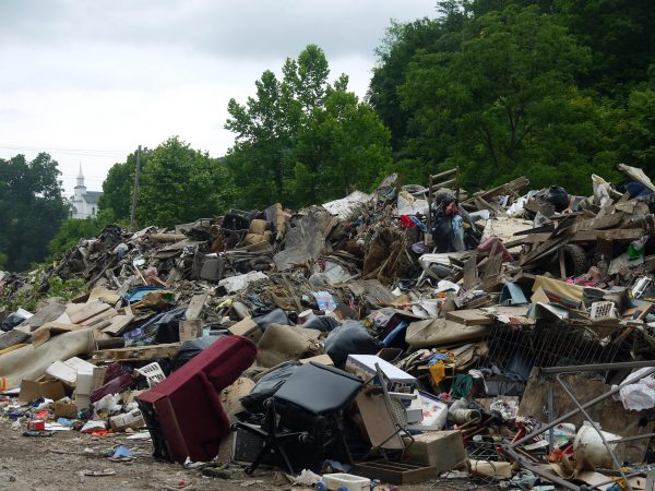Aftermath of the floods: Household belongings are now a mountain of debris. July 8, Clay County, WV. Photo by V.S.