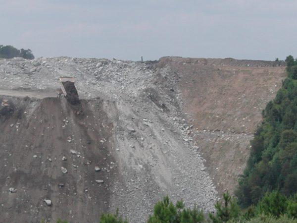 A gargantuan dump truck dumps former mountains,  making a valley fill. Photo by Vivian Stockman.