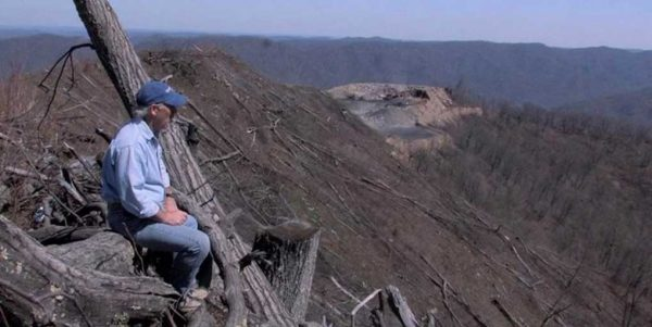In this still from Blood on the Mountain, retired miner and OVEC member Chuck Nelson ponders mountaintop removal coal mining. Photo courtesy Blood on the Mountain/Jordan Freeman/Abramorama.